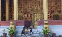 Local kids resting on temple steps