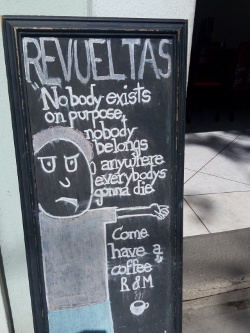 Sign outside Cafe Libreria Revueltas, Oaxaca