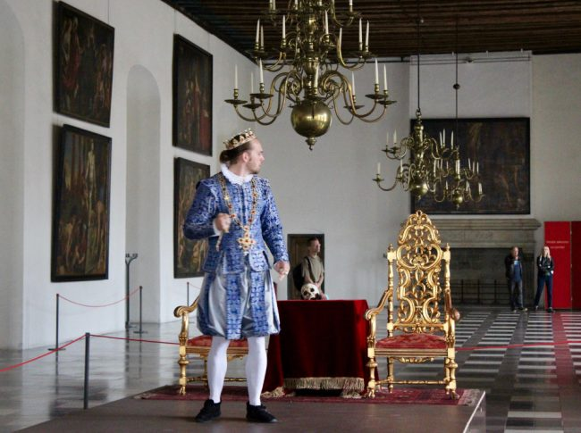 King Claudius during a scene (Hamlet's Castle)
