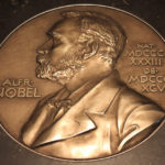 Large scale model of a Nobel medal on the floor of the Nobel Museum, Stockholm