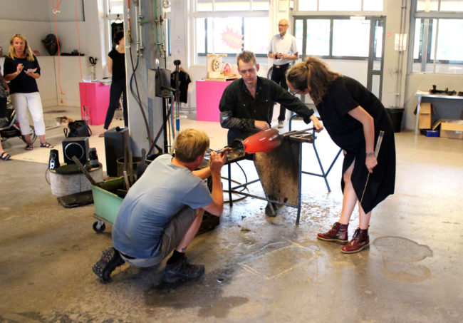 A Danish artist supervises her creation at The Glass Factory