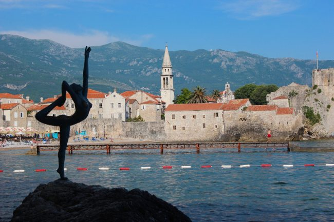 Statue of naked dancer and Old Town, Budva (guide to Kotor)