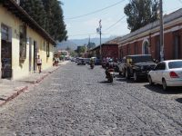 Rough cobblestones and cracked sidewalks in Antigua Guatemala