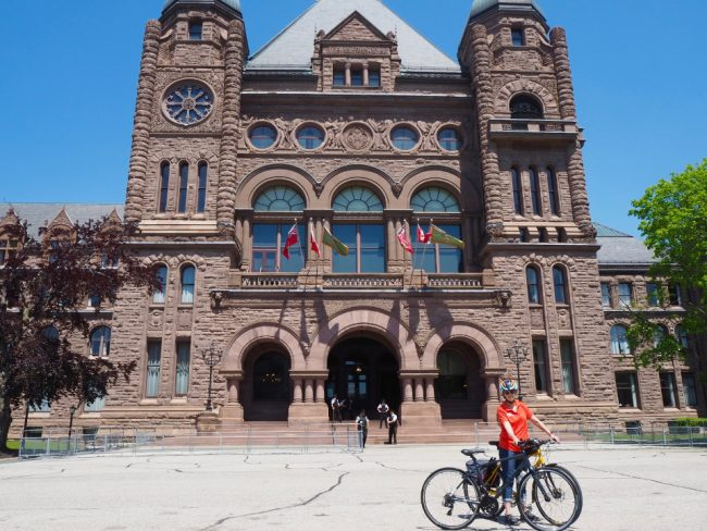 Wendy in front of the Ontario Parliament Building (guided cycling tour)