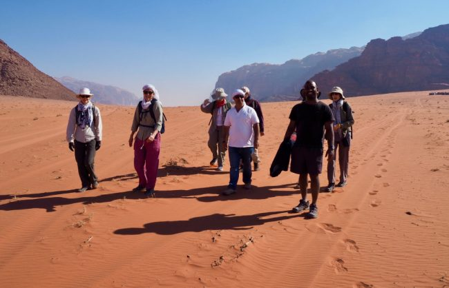 Tour group walking in Wadi Rum