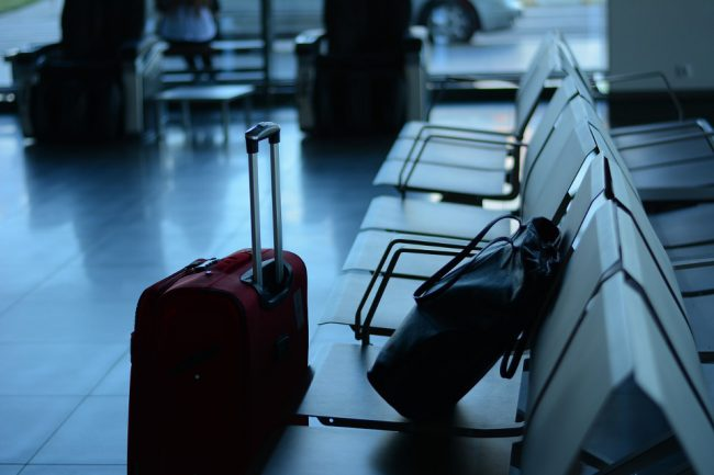 Luggage in airport terminal - travelling post-COVID