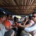 Backpackers in a long boat in Laos
