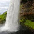 Walking behind Seljalandsfoss waterfall, South Coast of Iceland